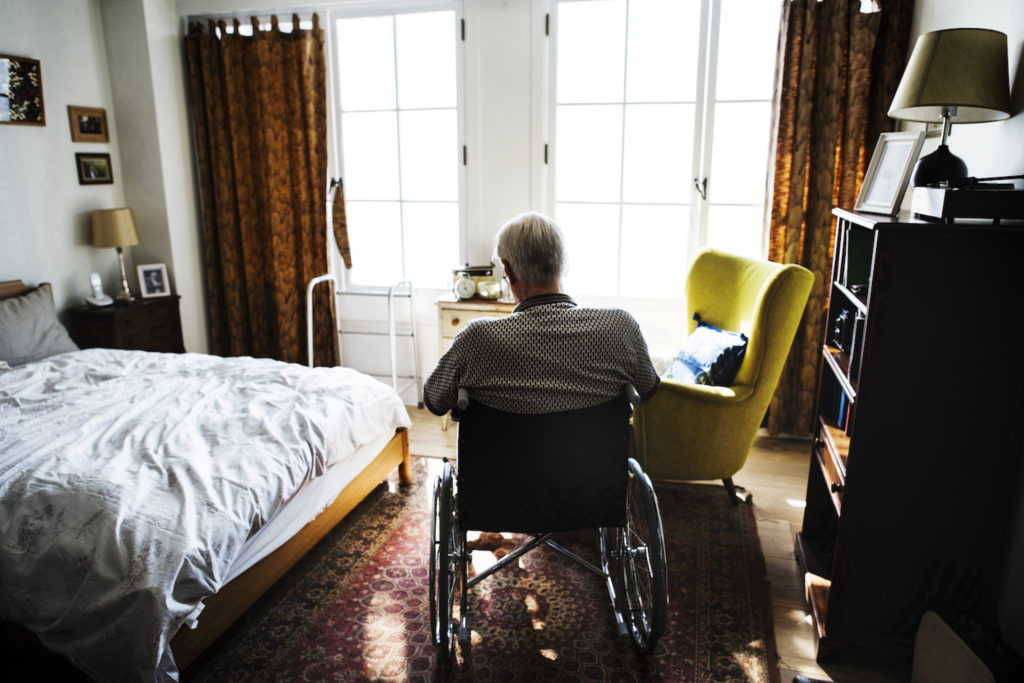 nursing home negligence lawyer concept Senior man sitting on the wheelchair alone