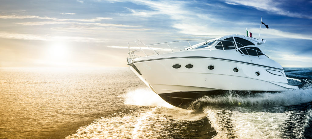 boating accident lawyer concept Luxurious motor boat sailing the sea at dawn