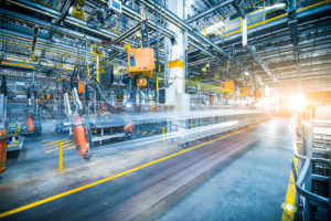 Workers' Compensation Accidents concept robots welding in a car factory