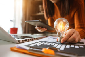 right business entity in missouri concept business hand showing creative business strategy with light bulb as concept